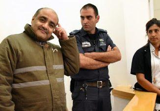 2016_12_6+El+Halabi+under+arrest+AFP-2c6ed663978facf482ee10743845bd19e18c720a