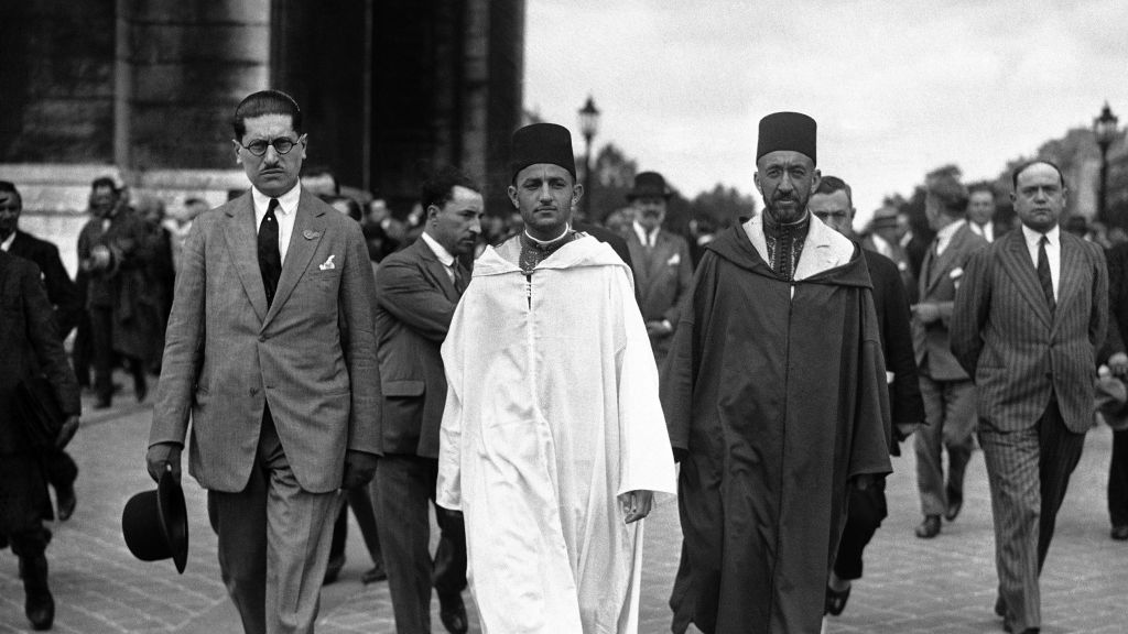 File: Morocco's Mohammed V, wearing white robes, walking with the country's Grand Vizier Si Mohammed El Mokri after he placed a wreath on the Tomb of the Unknown Warrior at the Arc De Triomphe during a visit to Paris, France around July 4, 1930. (AP Photo)