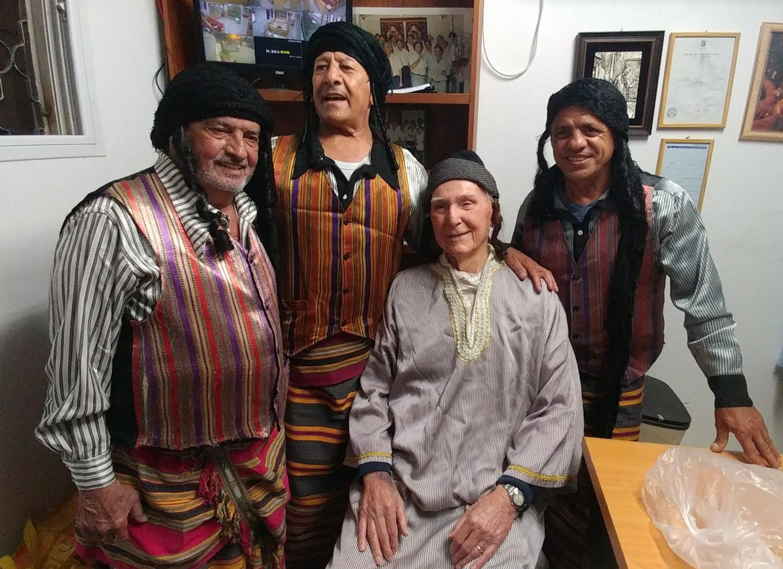 Captain Long (seated), wearing traditional Yemenite clothing and enjoying himself (Photo: Danny Beller)