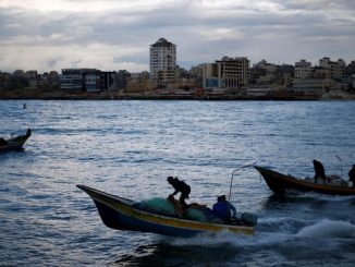 Palestinian-fishermen-ride-boats-at-the-seaport-of-Gaza-City-cca37754d60d1973ebf7356bb4931d6e6153e30d