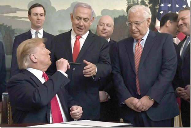 President-Donald-Trump-left-turns-to-give-a-pen-to-Israeli-Prime-Minister-Benjamin-Netanyahu-center-after-signing-a-proclamation (1)